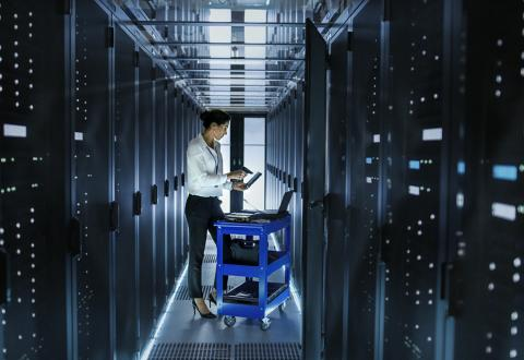 photo of a woman in a big computer room